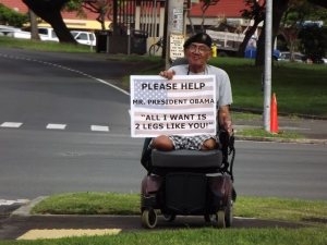 Please help Mr. President Obama all I want is 2 legs like you, disabled Veteran Charles Canamar holds his sign as President Obama and the Motorcade passes the double amputee by
